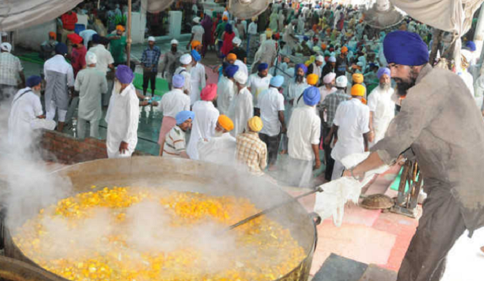 Sikh man prepares Langar for the devotees. Ingredients used for making Langar, Prasad and Bhandara are now GST-free. Pic: Tribune India