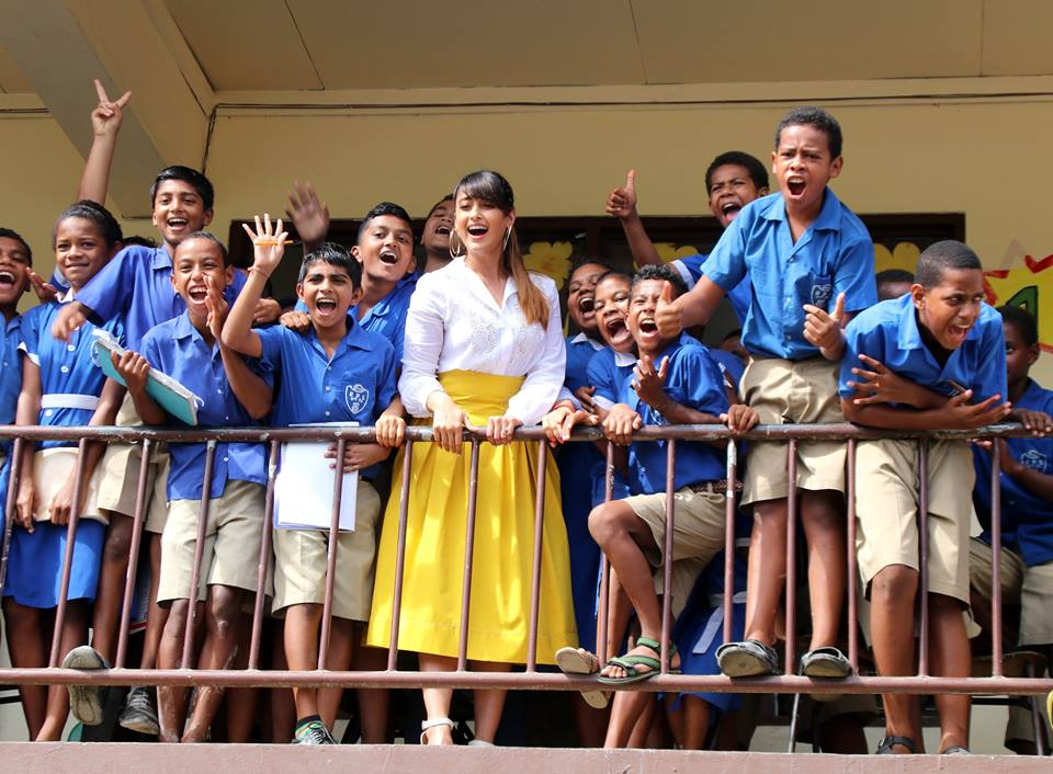 Ileana D'Cruz poses for a picture with the students of Rampur Primary School in Navua today.