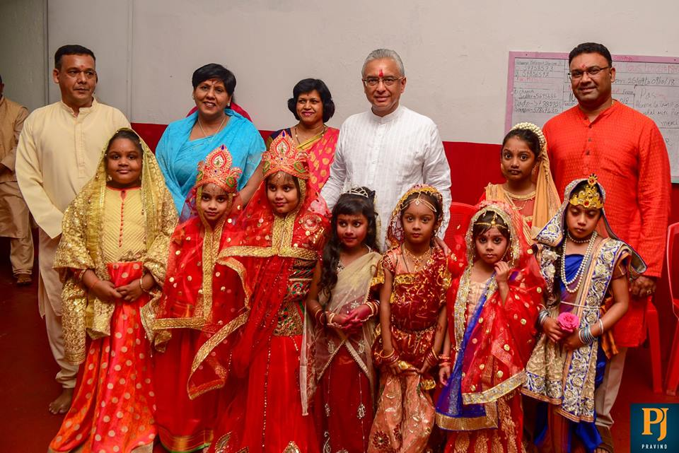 Prime Minister of Mauritius Pravind Jugnauth with young Hindu devotees during Navratri puja on October 18th 2018. Navratri is celebrated with great vigor in the country and the country boasts of the world's biggest Goddess Durga statue.